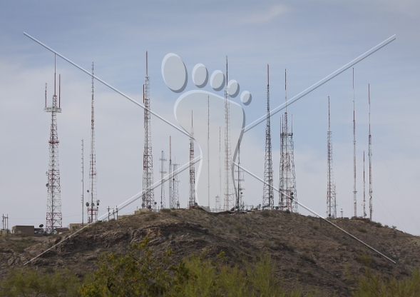 Communication Towers and Antennas on Hilltop.